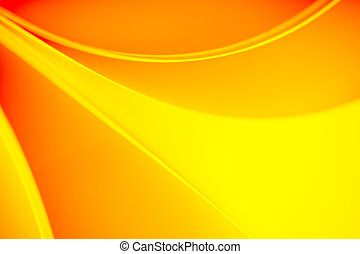 background macro image of a pattern made of curved sheets of paper in yellow and orange colour tones.