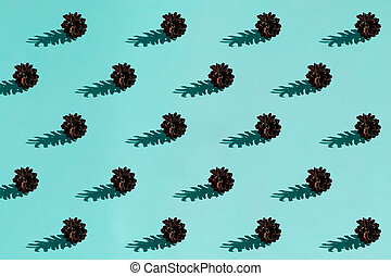 Background made from pinecone on the blue background