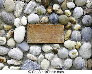 background made of a wall with pebbles