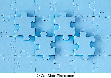 Background made of blue puzzle pieces