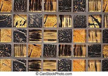 Background made of colored ceramic tiles with a golden mosaic.