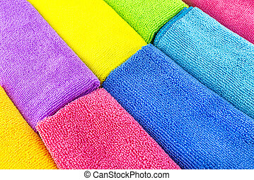 Background made of different colors of microfiber material stacked side by side, top view.