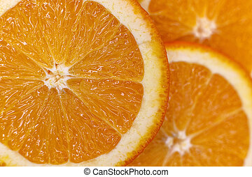 background made with a heap of sliced oranges