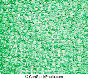 background of a green knitted fabric. texture