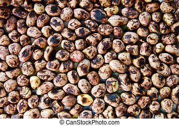 Background of a heap of roasted peanuts.