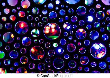 Abstract background with circles illuminated with multicoloured flashlight.