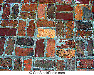 Antique bricks and thick mortar in a basket weave pattern