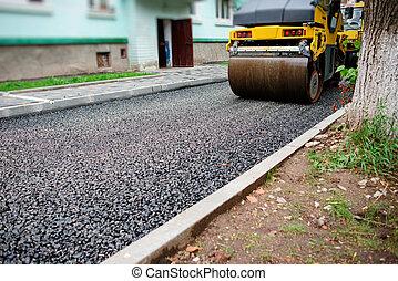 Background of asphalt roller that stack and press hot ...