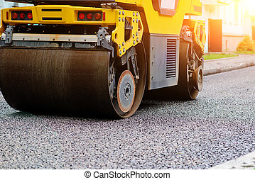 Background of asphalt roller that stack and press hot...