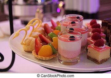 assorted fresh sweet tarts and pastries
