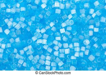 background of blue decorative plastic craft beads