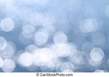 Background of blue water with sun reflections