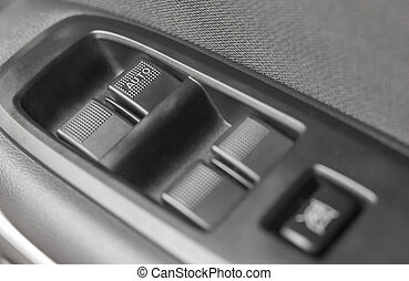 Background of car lock unlock buttons and window buttons.