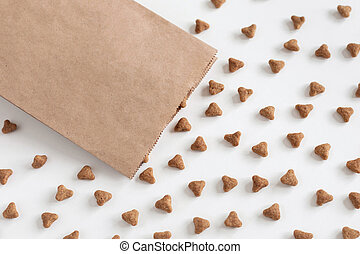 Background of cat dry food and paper packaging. Domestic kitty care. Natural backdrop