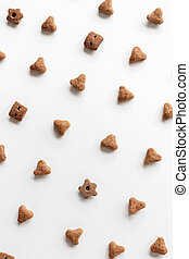 Background of cat dry food. Minimalistic white flat. Domestic kitty care. Natural backdrop