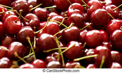 Background of cherries rotating - Background 4k video of...