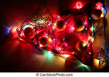 Background of Christmas decorations and gifts with multi-colored