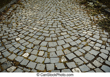 Background of cobbles with grass in the city center
