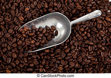 Background of coffee beans with scoop