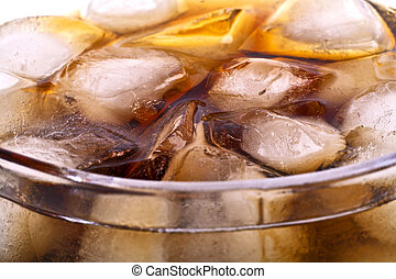 Background of cola with ice cubes and bubbles