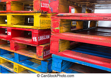 background of colorful wooden cargo pallets