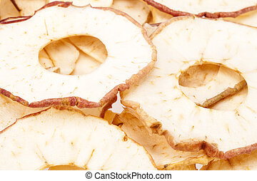 background of dried apple slices, close up