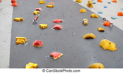 Background of empty climbing wall in a climbing center. -...