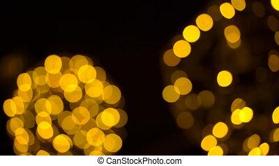Background of flicker of golden lights. 4K