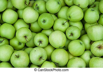 Background of fresh green Granny Smith apples
