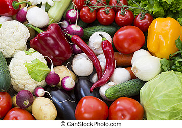 Background of fresh vegetables greens and tomatoes