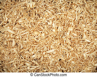Background of fresh wood shavings yellow color on the table