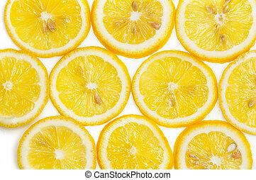 Background of fresh yellow lemon slices on white