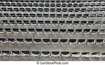 background of gray chairs without the spectators