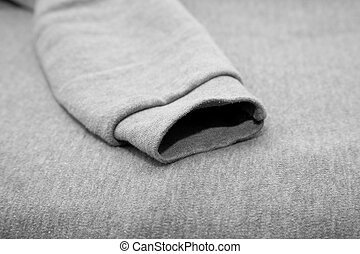 background of gray fabric with sleeves