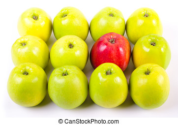 Background of green apples with one red apple