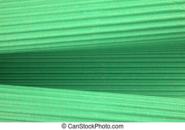 Background of green corrugated cardboard