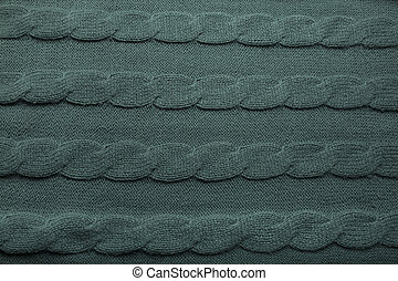 Background of green wool knitted sweater