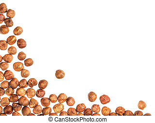 Background of hazelnuts with copy space.
