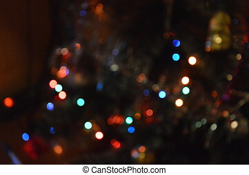 Background of illuminated Christmas tree garland in the interior