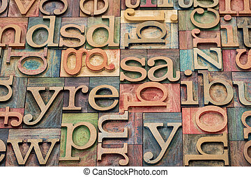 background of letterpress wood type printing blocks stained by color inks