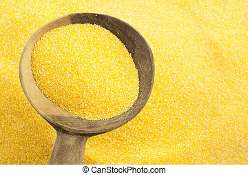 background of maize flour and wooden spoon