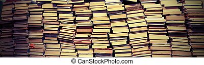 Background of many books of many sizes for sale in the...