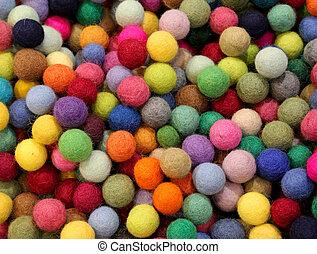 background of many felt balls