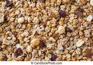 Background of Muesli Breakfast with oat flakes raisins. Close-up view of the crispy granules. The concept of Healthy eating.