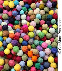 background of multicolored felt balls