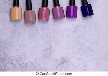 Background of multicolored nail polish samples. Top view of the color palette of nail services in beauty salon. Fashion manicure. Gel lacquer. Nail design