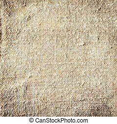 Background of natural burlap with a coarse woven texture and...