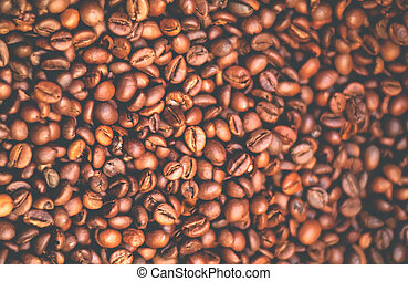 Background of natural coffee beans. Abstract blurred Caramel background .