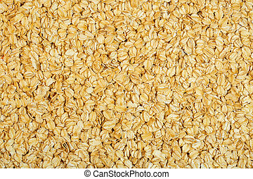 background of oat flakes top view
