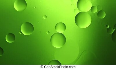 Background of oil drop in the water. - Green background of...